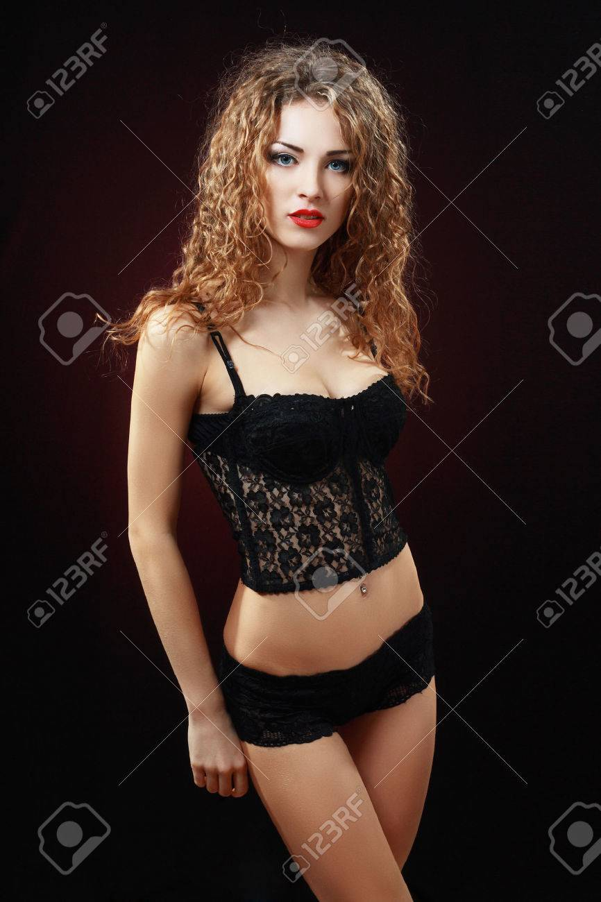 14a8e54fac1 hot beautiful young woman in black lingerie over dark background Stock  Photo - 40840486