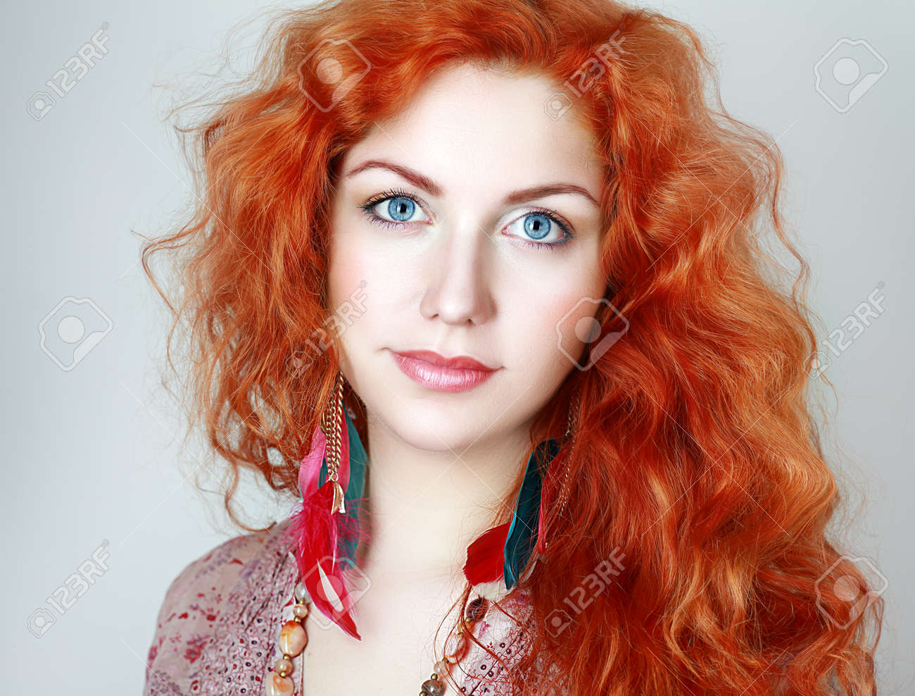 Astonishing Portrait Of A Young Woman With Red Hair And Blue Eyes Stock Photo Hairstyles For Women Draintrainus
