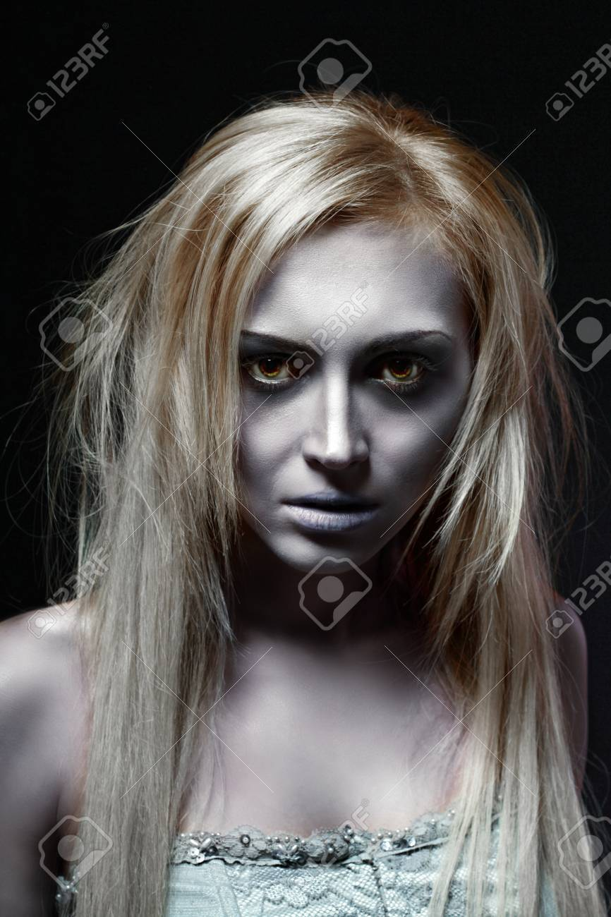 Portrait Of Beautiful Zombie Corpse Bride Looked Scary And Standing At Dark  Background. Halloween Concept