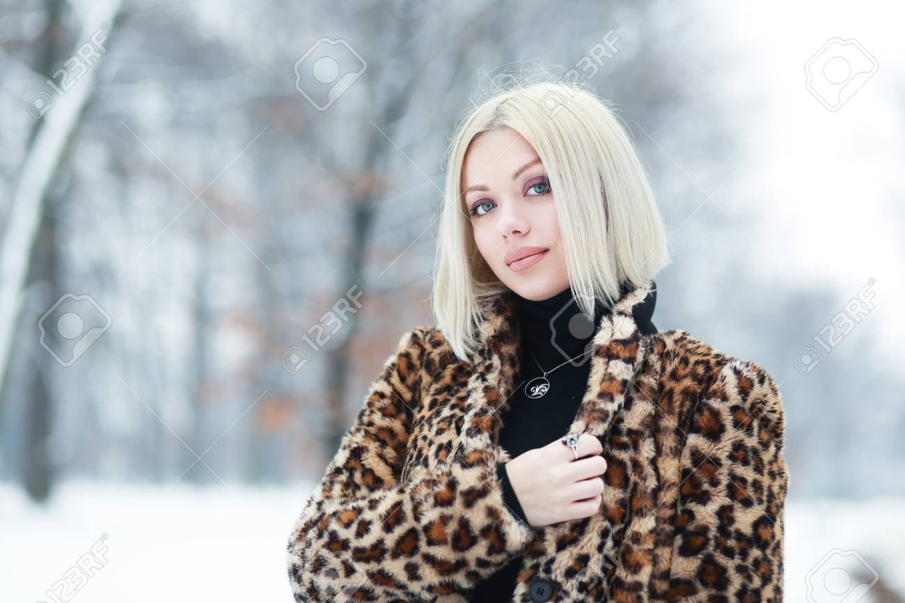 d121833bf Young Blond Woman Portrait In Winter Park Weared In Furry Coat Stock ...
