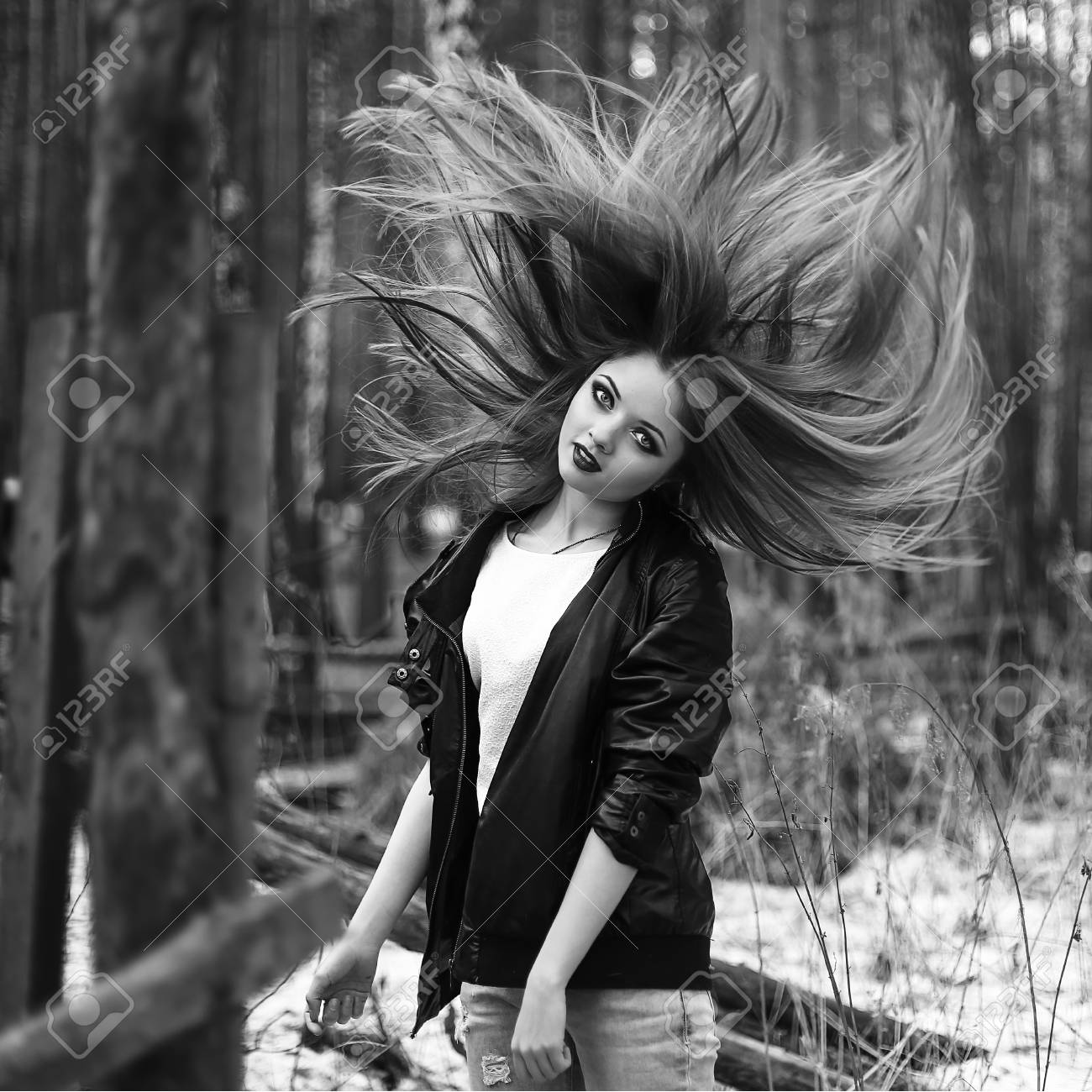 Stock photo the girl in a leather jacket the black and white photo poses in the wood