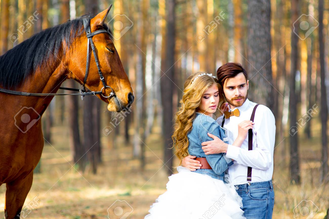 Couple Posing On A Horse Stock Photo Picture And Royalty Free Image Image 57653678