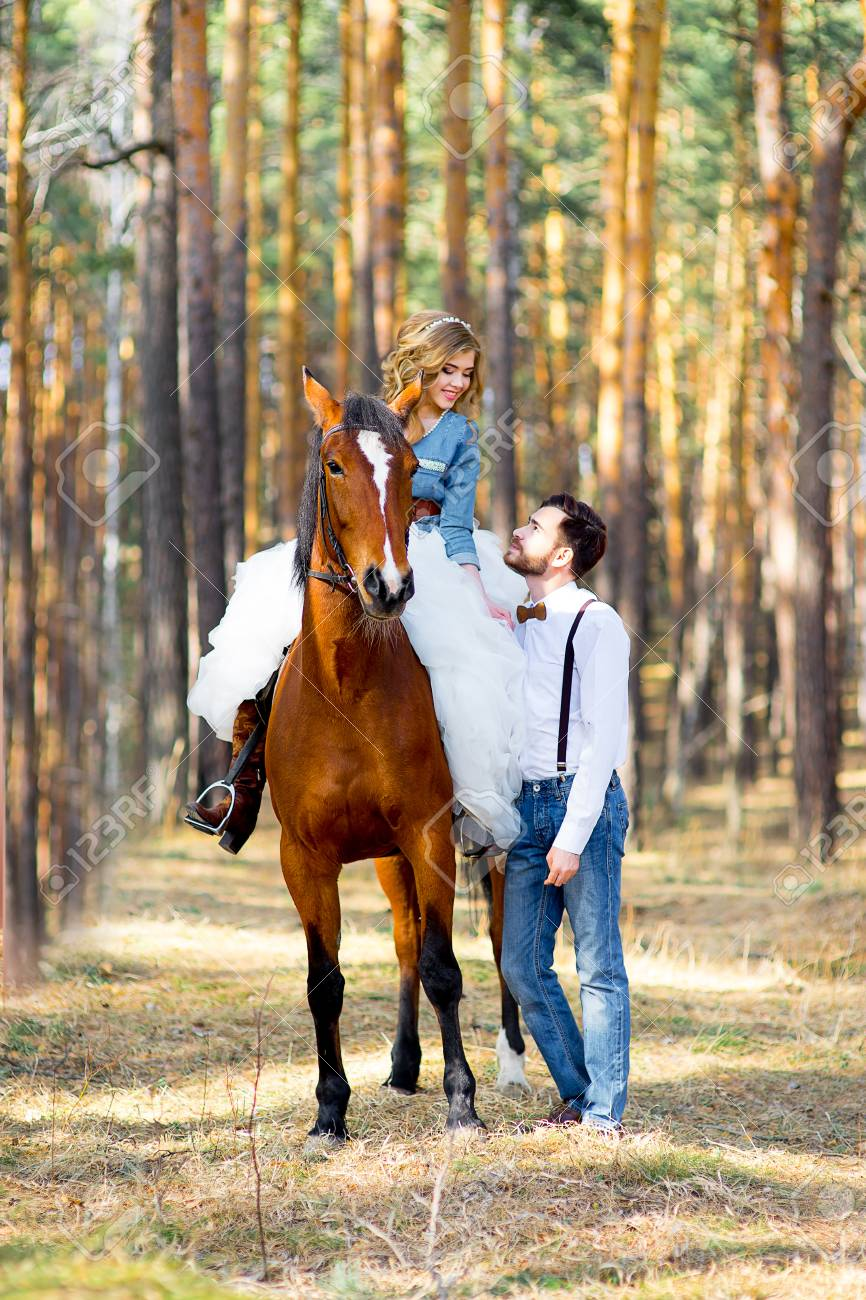 Couple Posing On A Horse Stock Photo Picture And Royalty Free Image Image 57653541