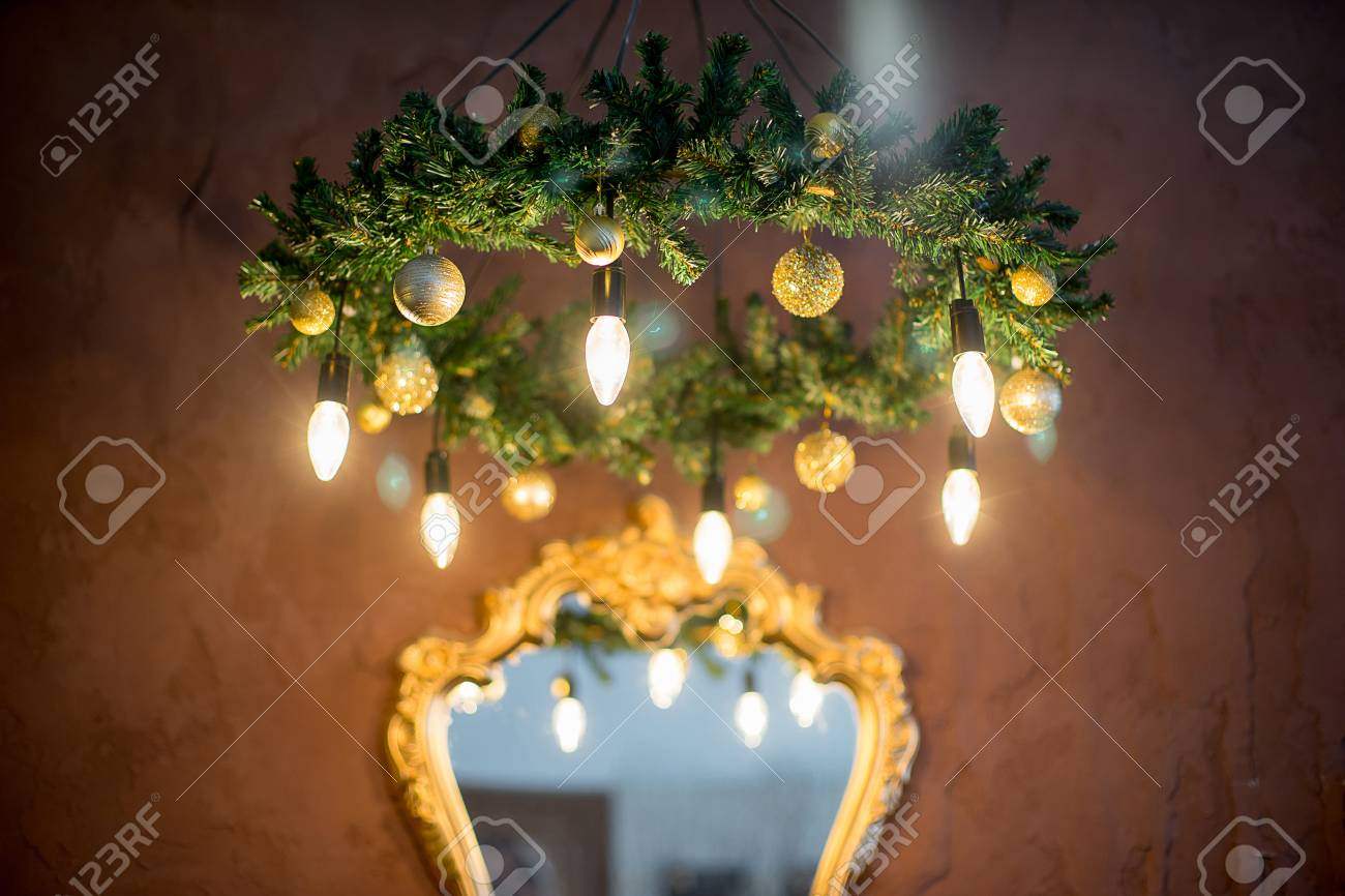 Christmas tree mirror chandelier christmas interior in purple christmas tree mirror chandelier christmas interior in purple and gold colors stock photo aloadofball Image collections