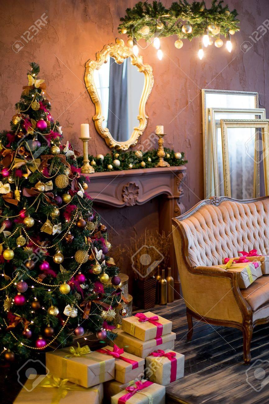 Christmas tree mirror chandelier christmas interior in purple christmas tree mirror chandelier christmas interior in purple and gold colors stock photo aloadofball Choice Image