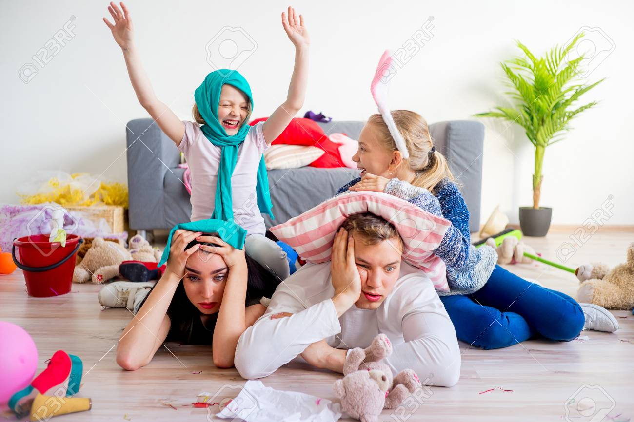 Tired Parents And Romping Kids Stock Photo, Picture And Royalty ...