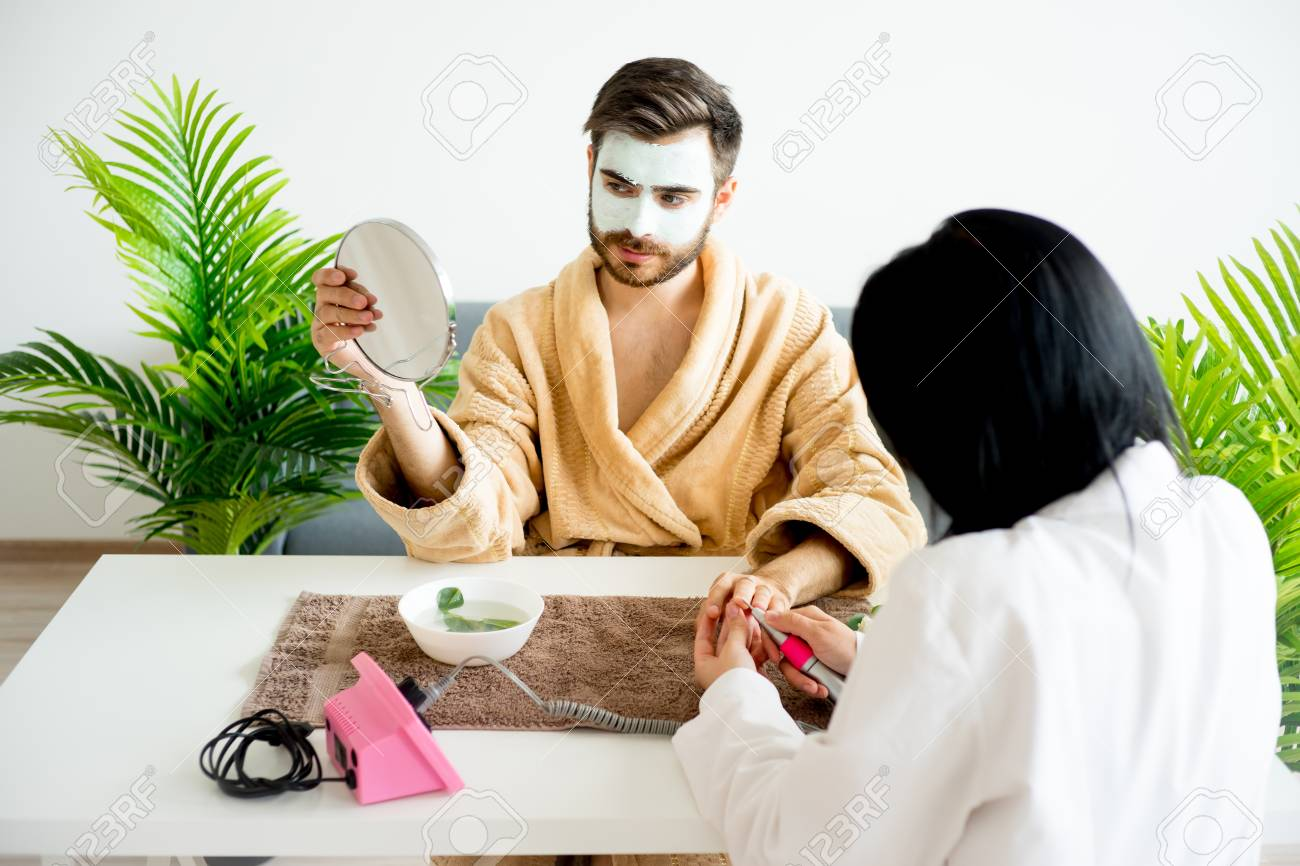 Man Is Having His Nails Done Stock Photo, Picture And Royalty Free ...