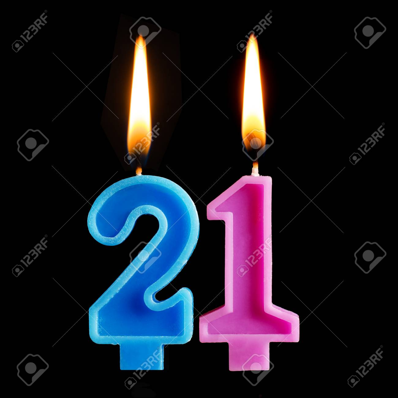 Burning Birthday Candles In The Form Of 21 Twenty One For Cake Stock Photo Picture And Royalty Free Image Image 100666274