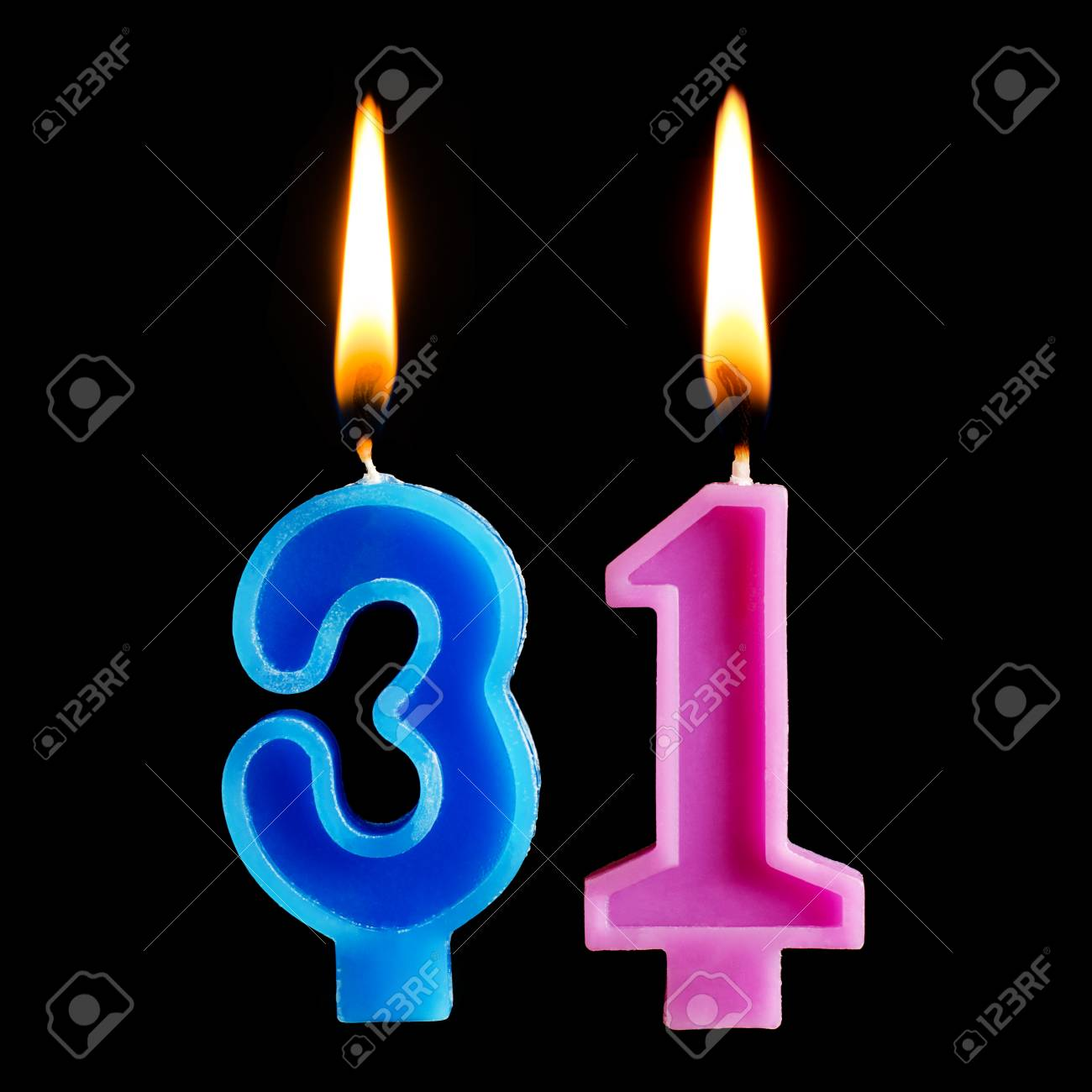 Burning Birthday Candles In The Form Of 31 Thirty One For Cake Isolated On Black Background