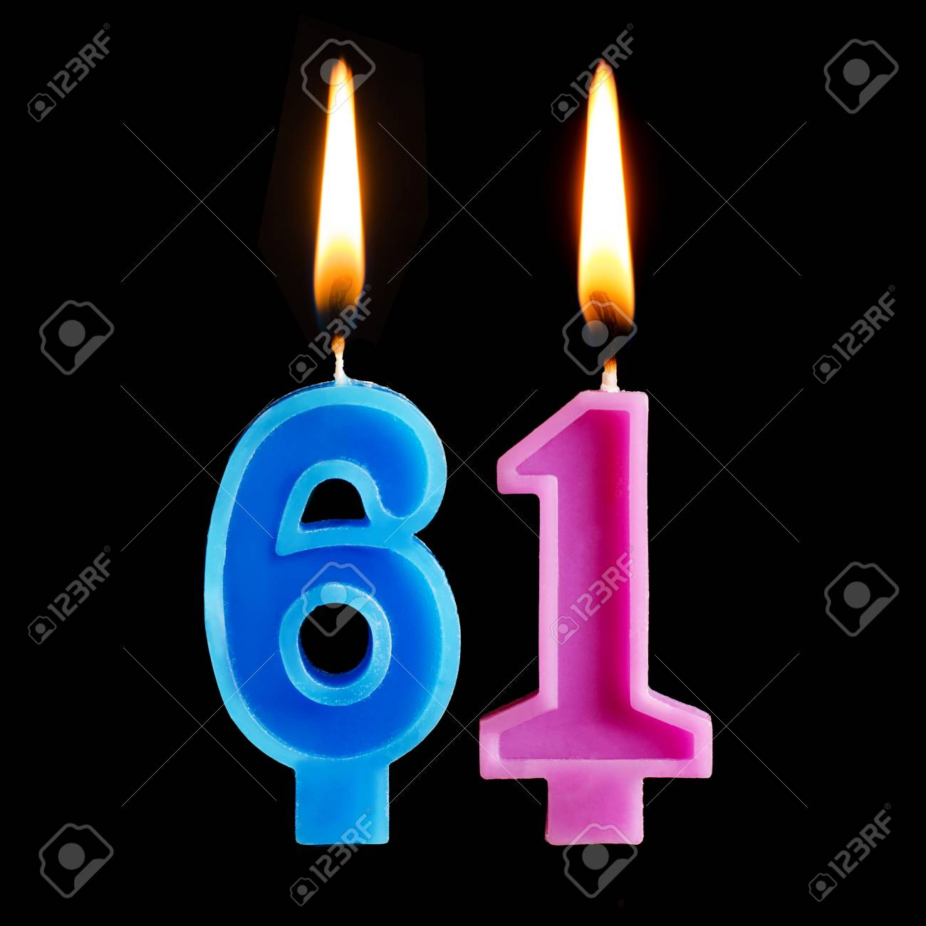 Burning Birthday Candles In The Form Of 61 Sixty One For Cake Isolated On Black Background