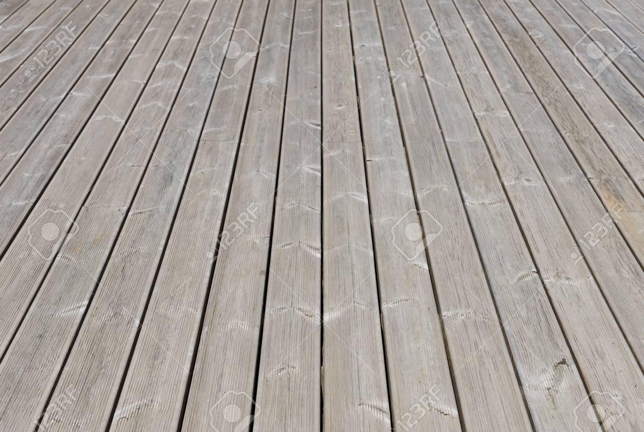 Vieux extérieur en bois sol de la terrasse en toile de fond