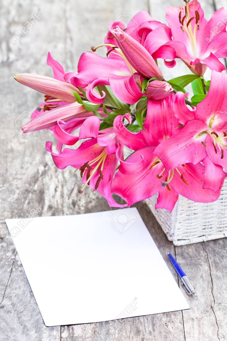Pink Lily Flowers Bouquet And Blank Paper Sheet With Pen On.. Stock ...