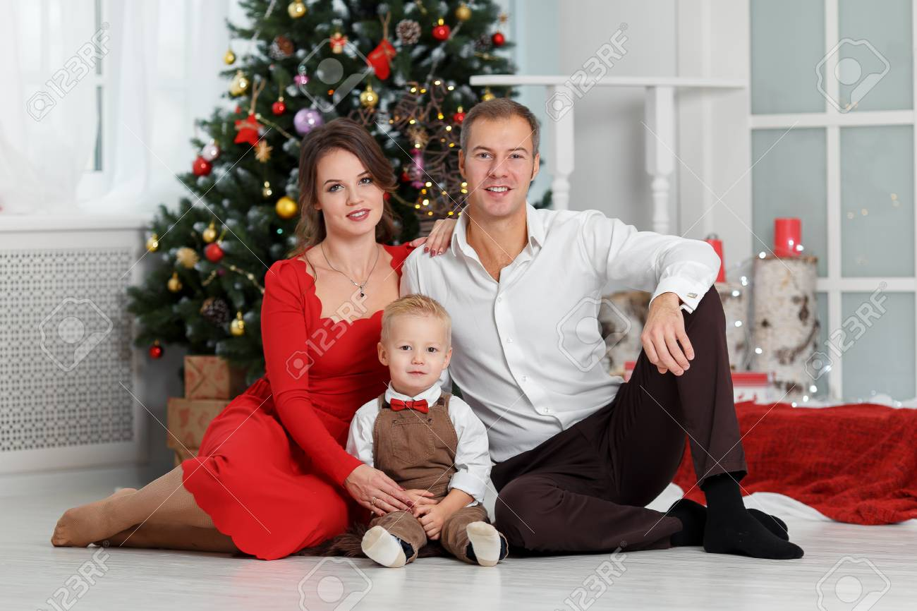 Happy Family With Child Son Sitting Near Christmas Tree. Beautiful ...