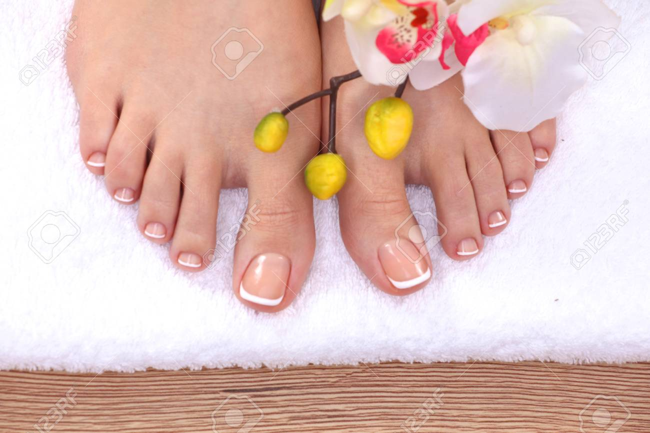 Beautiful Feet With Perfect Spa French Nail Pedicure . Stock Photo ...