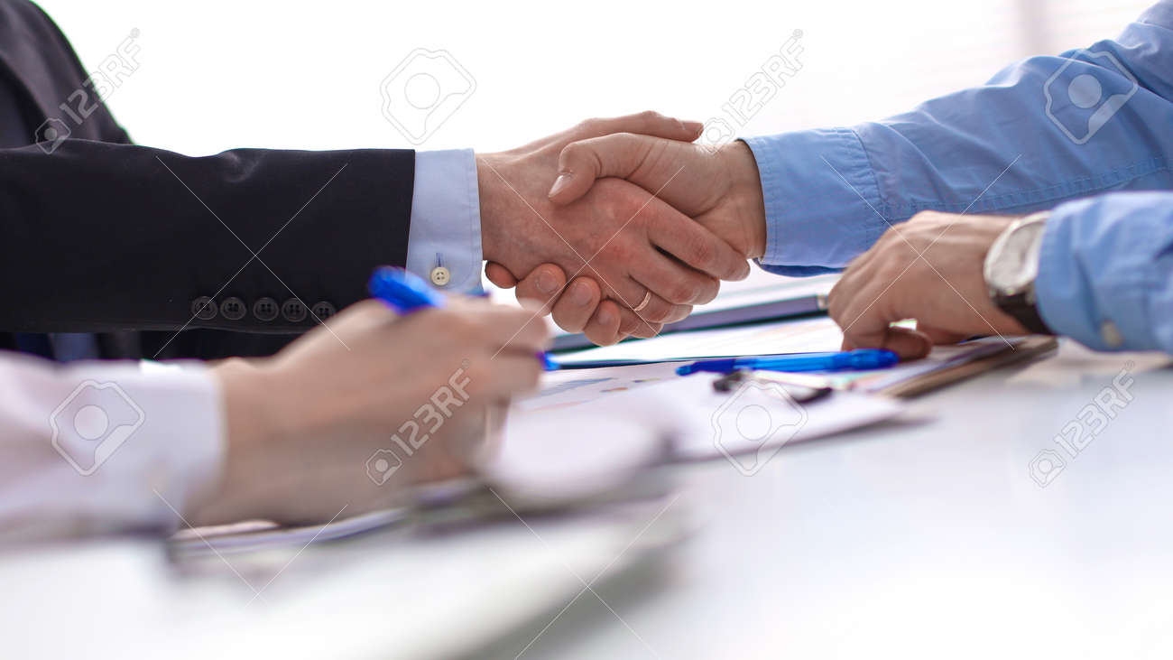 Business handshake. Two businessman shaking hands with each oth - 128941486