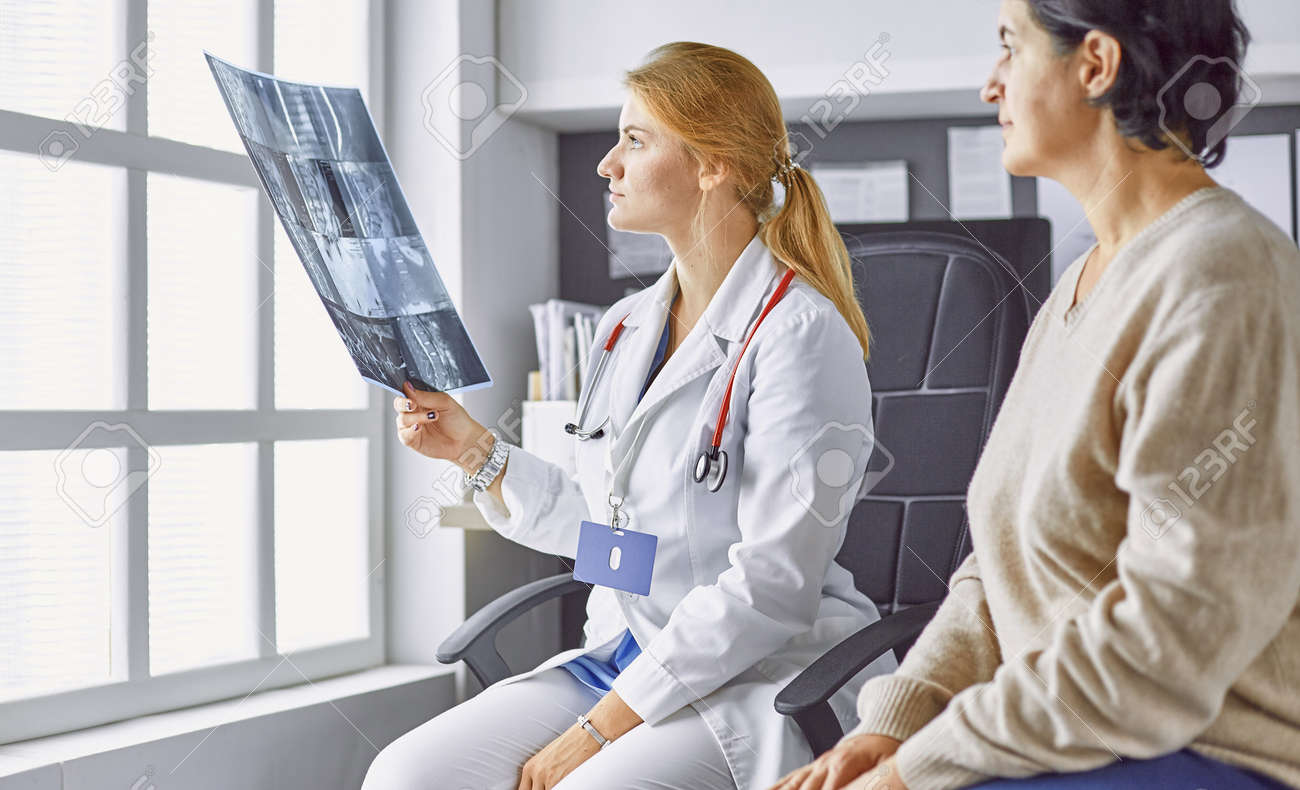 young woman doctor takes patient in office - 156240486