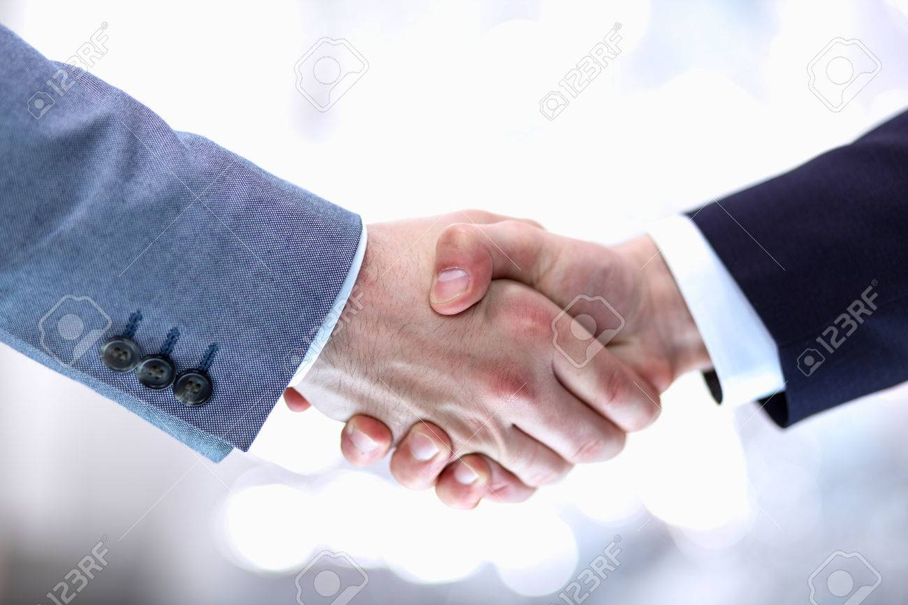 Businessmen shaking hands, isolated on white background. - 50336822