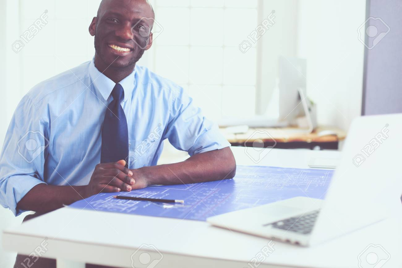 African American Architect Working With Computer And Blueprints Stock Photo Picture And Royalty Free Image Image 109038603