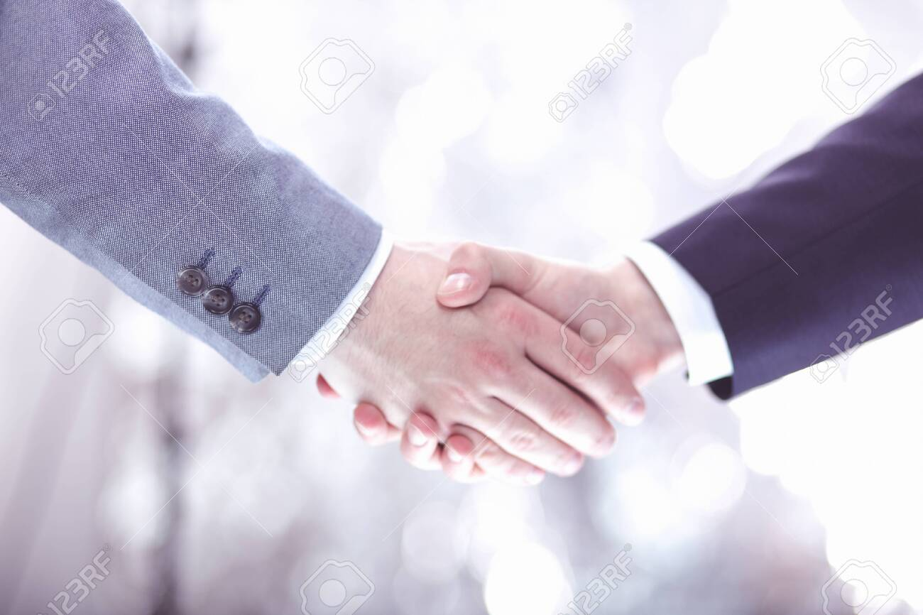 Closeup of a businessman hand shake businesswoman between two colleagues OK, succeed in business - 128379454