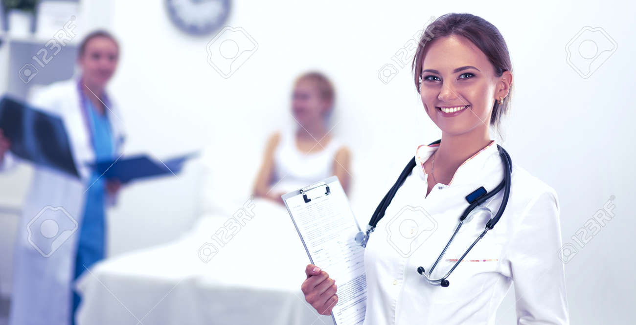 Woman doctor standing at hospital - 147626521