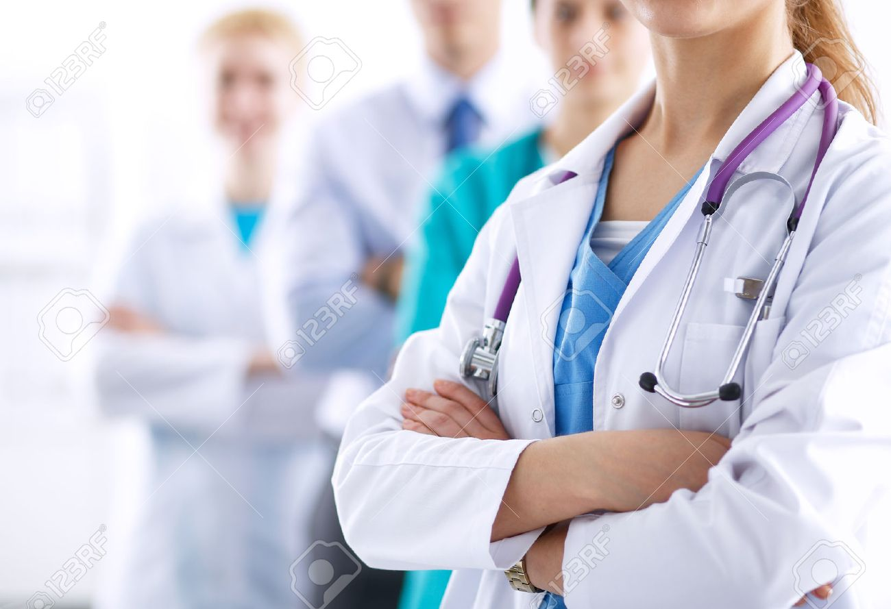Attractive female doctor in front of medical group . Stock Photo - 42234811
