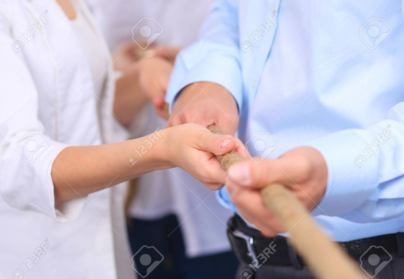 Concept image of business team using a rope as an element of the teamwork - 53906189