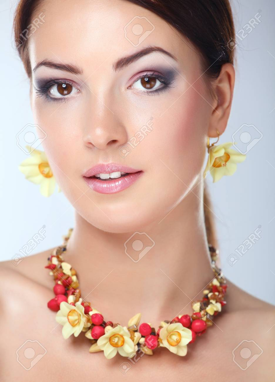 Portrait of young beautiful brunette woman in beads . - 128240209