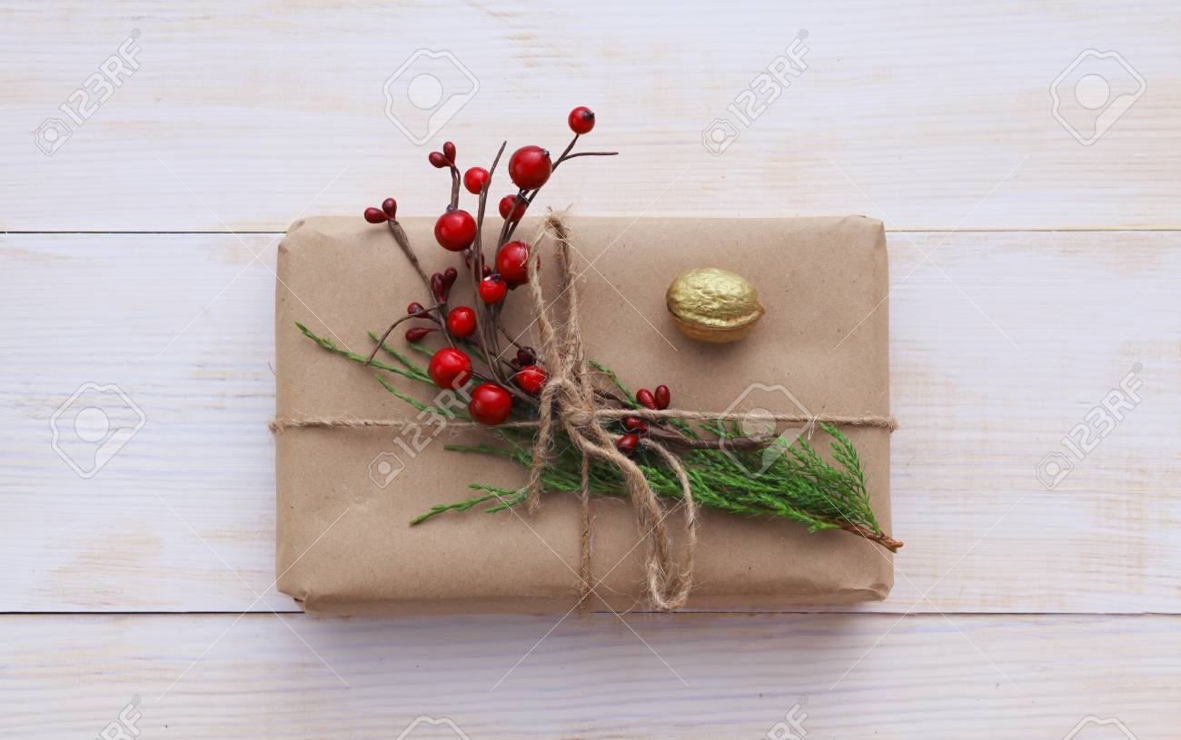 Christmas gift boxes and fir tree branch on wooden table flat lay christmas gift boxes and fir tree branch on wooden table flat lay negle Images