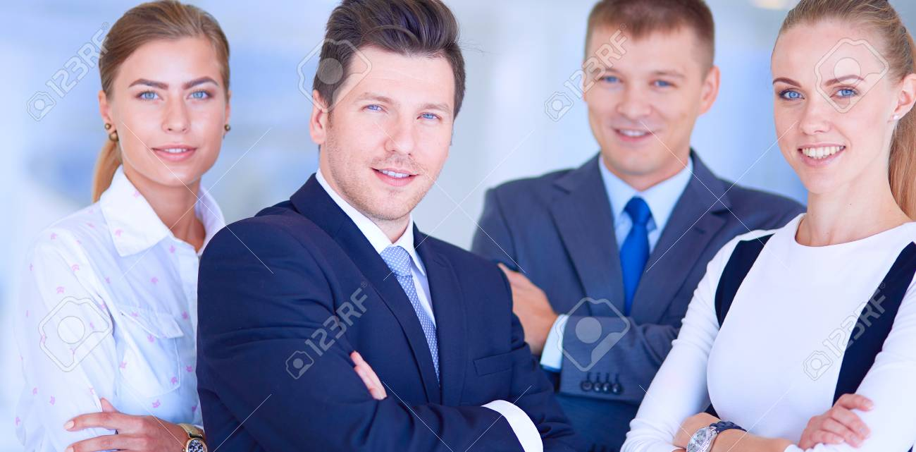 Happy business team showing thumbs up in office. Happy business team - 126550589