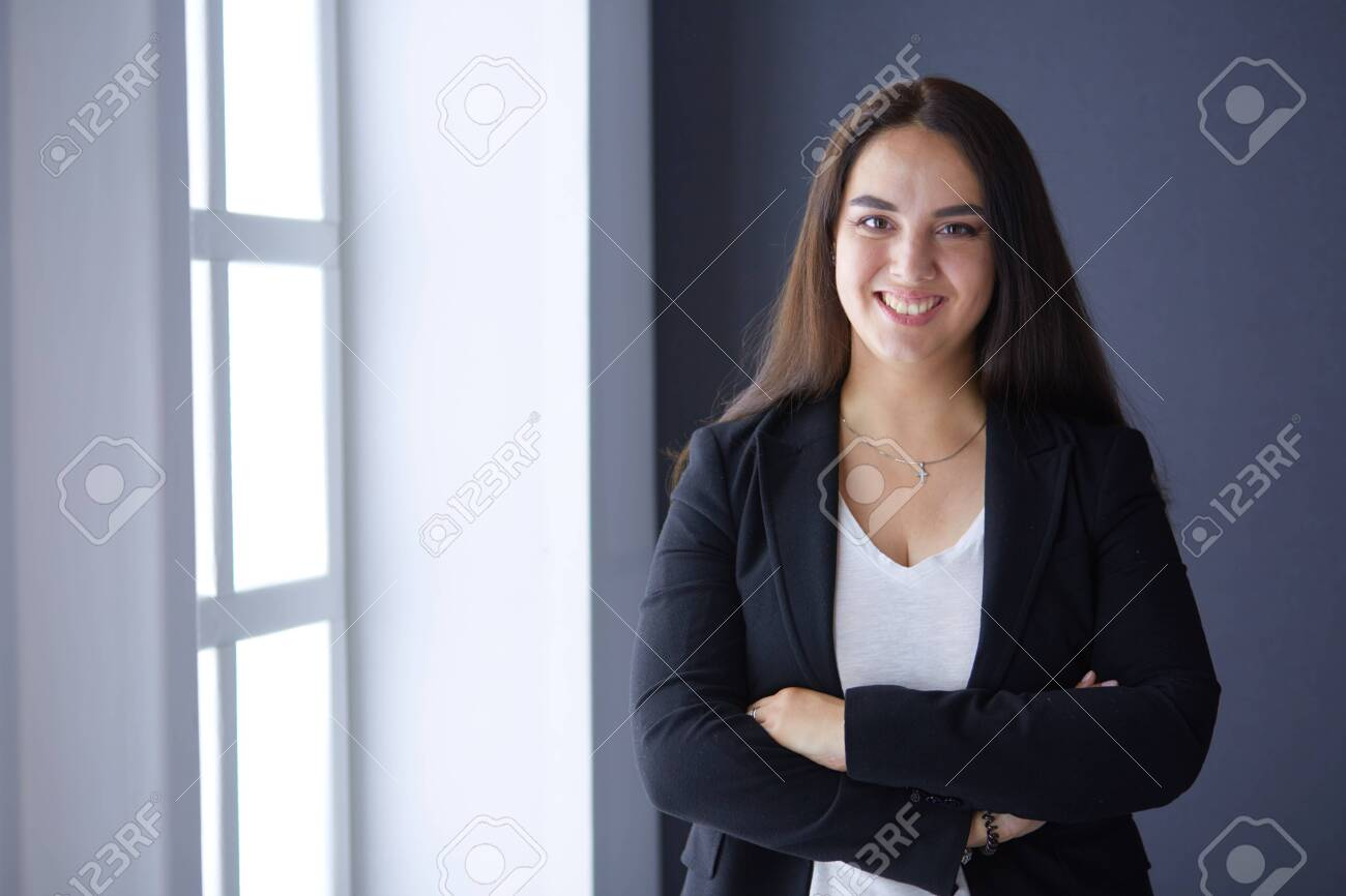 Modern business woman standing in the office . - 137329405