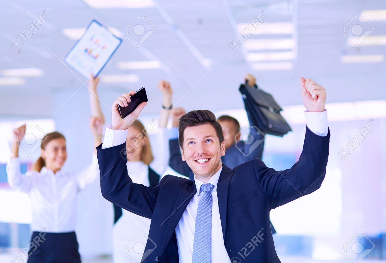 Business team celebrating a triumph with arms up - 155704230