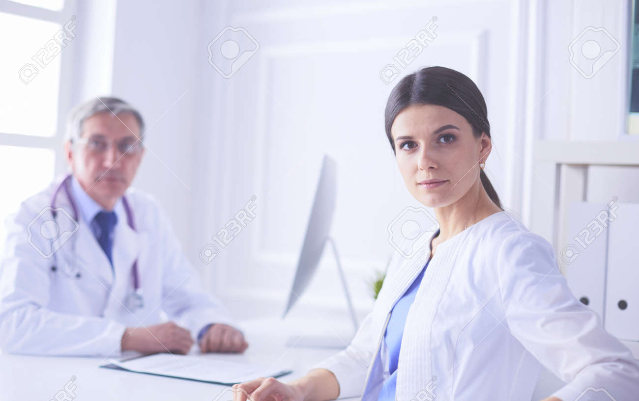 Two doctors smiling in consulting room in hospital - 169252699