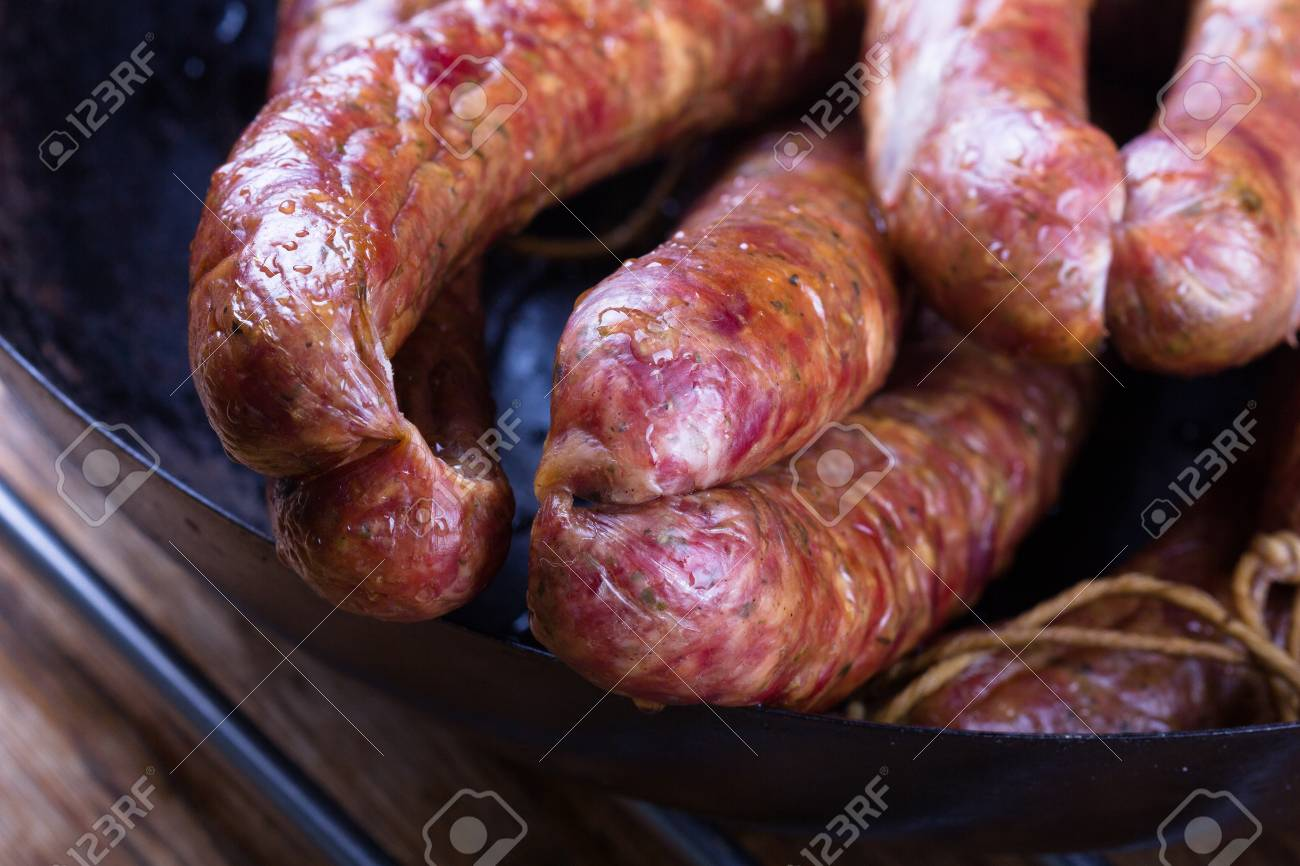 Traditional Polish pork sausages just taen from the smoker. - 76272028