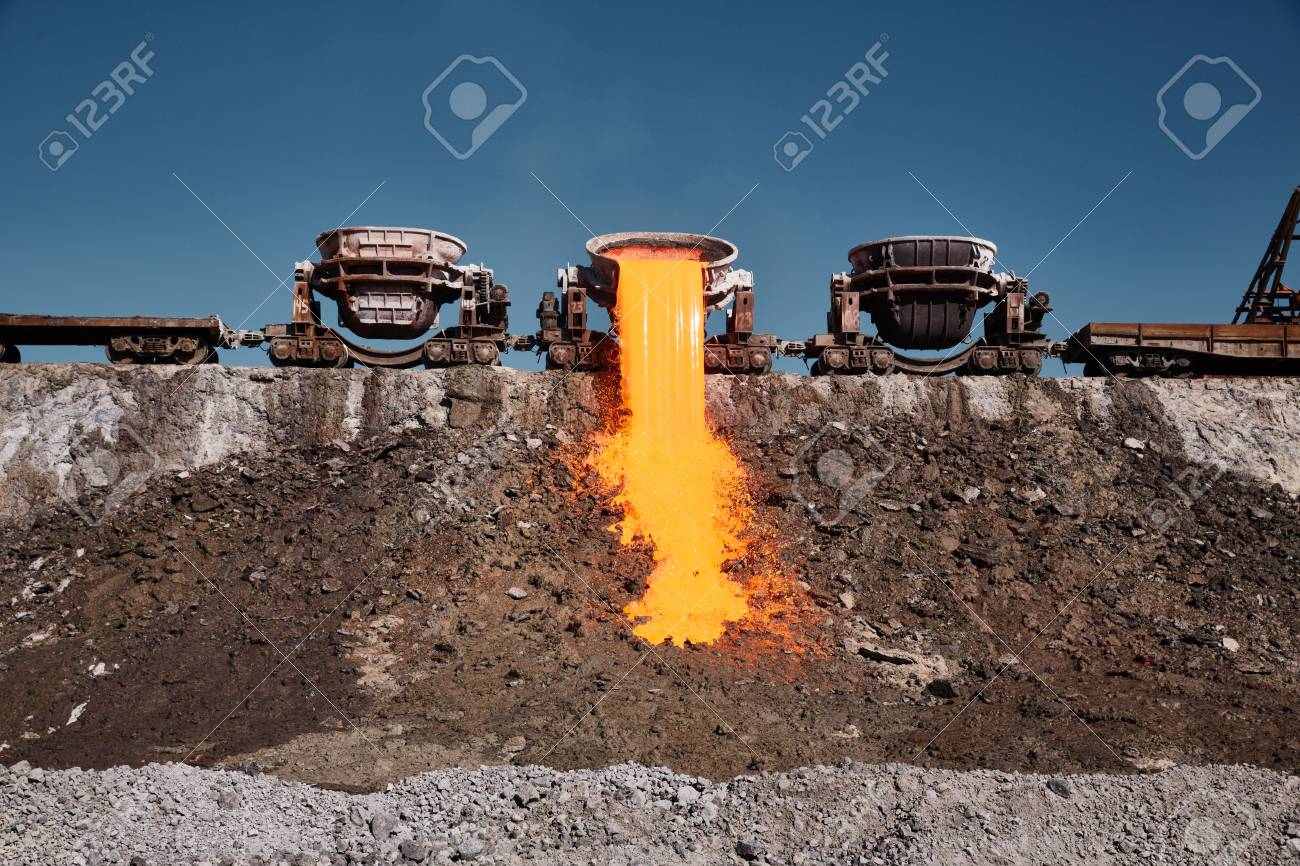 The molten slag is poured from a crucible mounted on a railway