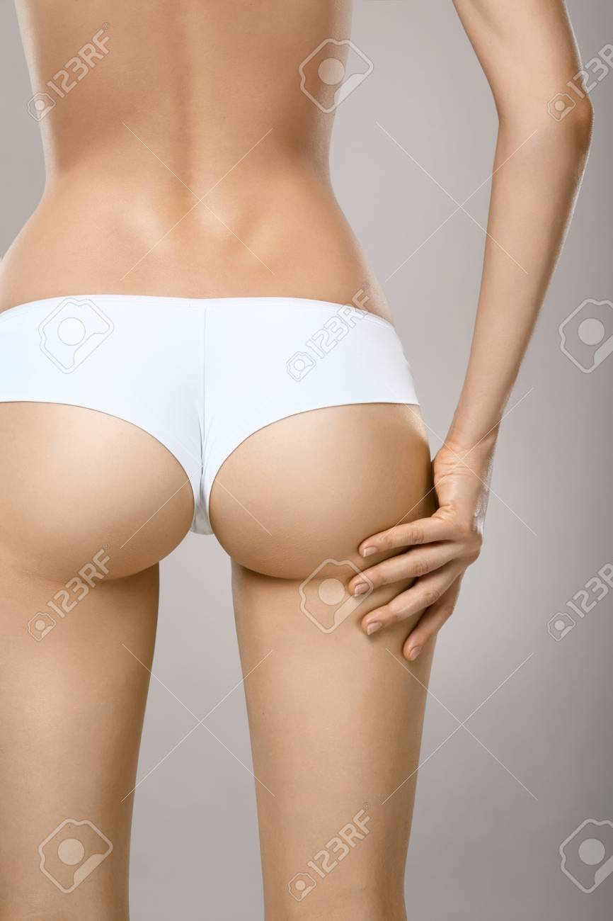 85f54108453 Closeup of female with fit slim body in panties and bra suffering from pain  and holding