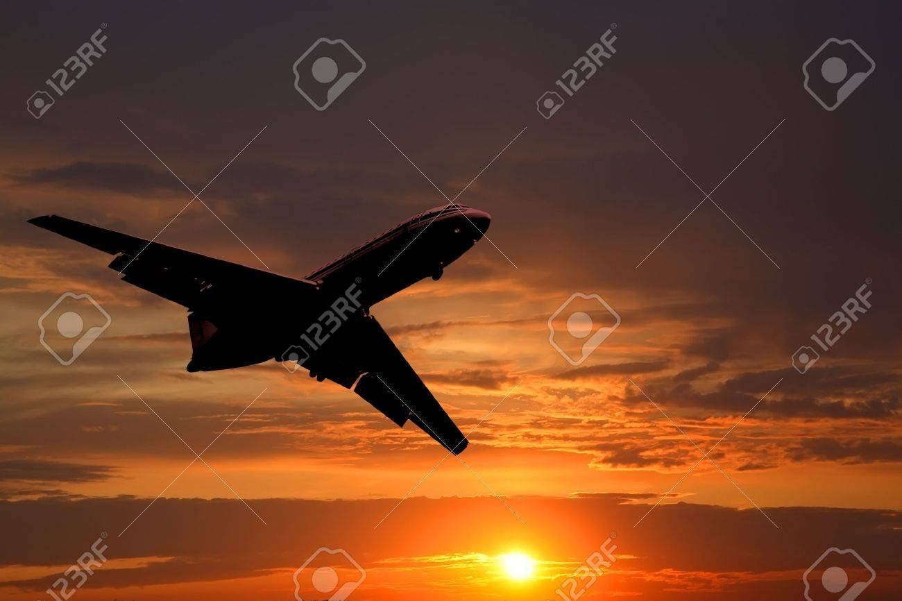 Silhouette of the big plane on a sunset background Stock Photo - 5497925