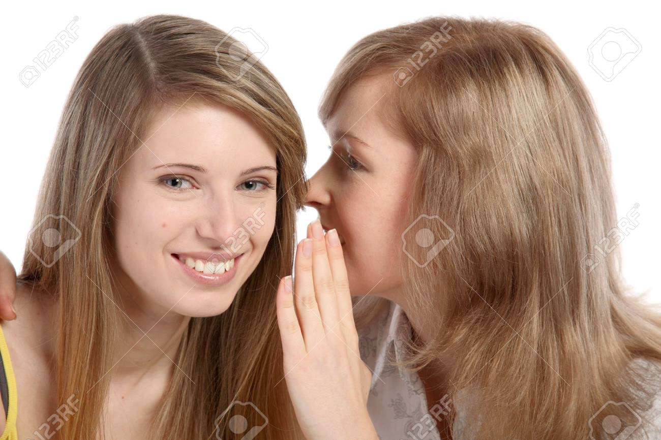 Two girlfriends talk. Close up. White background. It is isolated. Stock Photo - 5878908