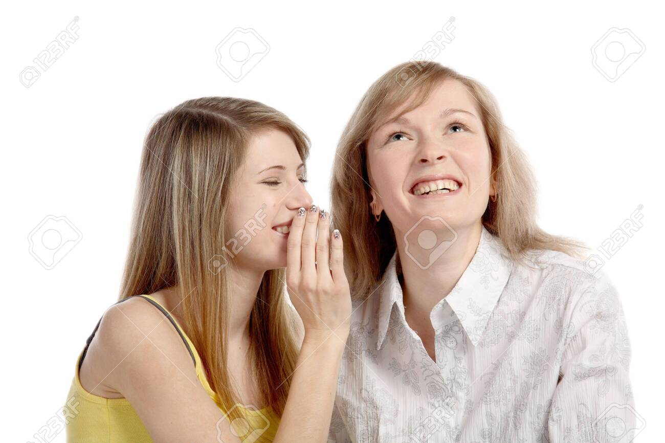 Two girlfriends talk. Close up. White background. It is isolated. Stock Photo - 5878858