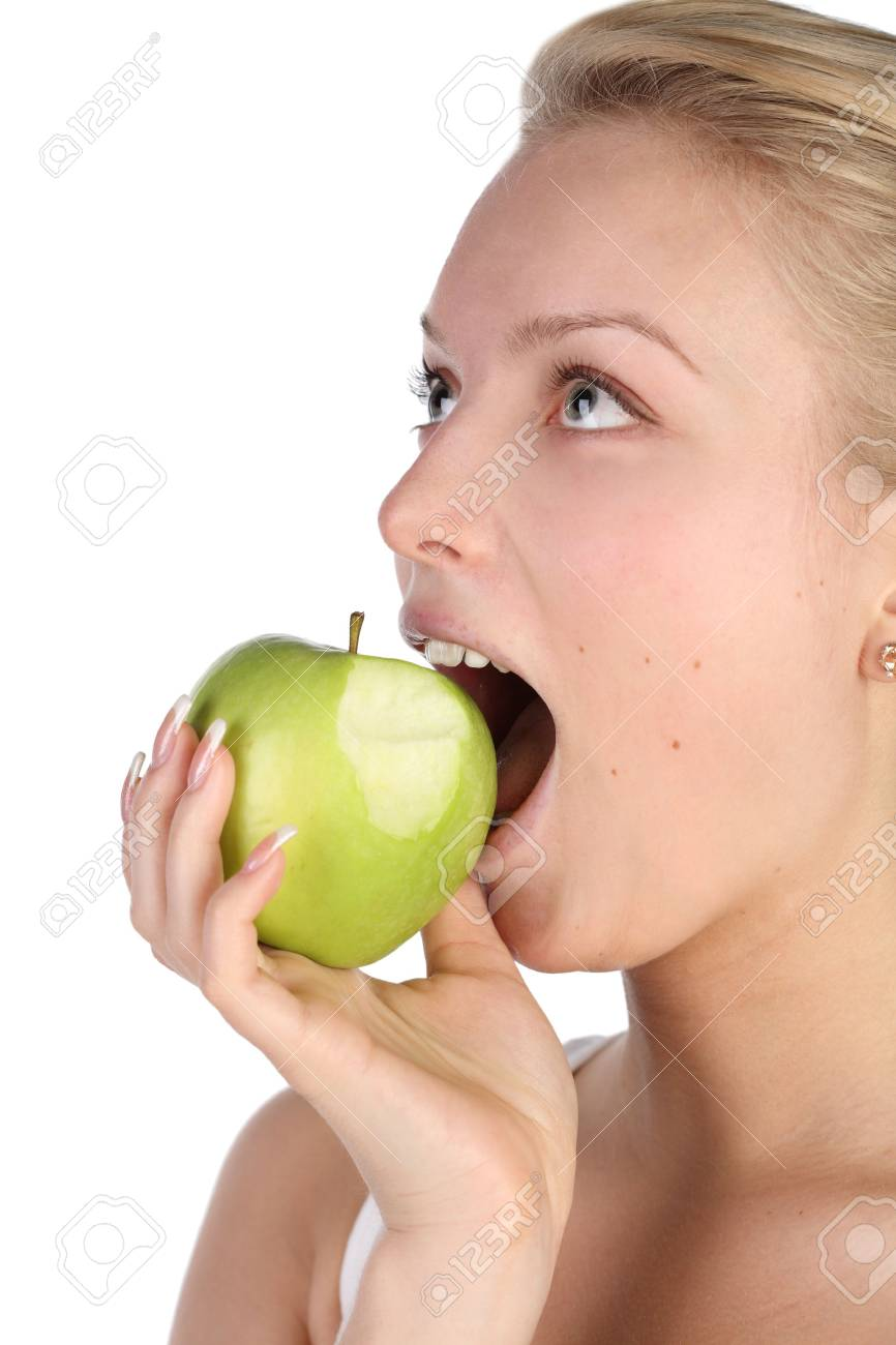 girl bites off from the big green apple Stock Photo - 7028207