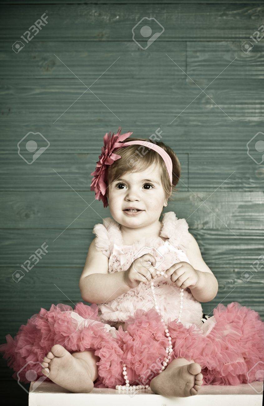 elegant little girl in a bright pink dress Stock Photo - 9759903