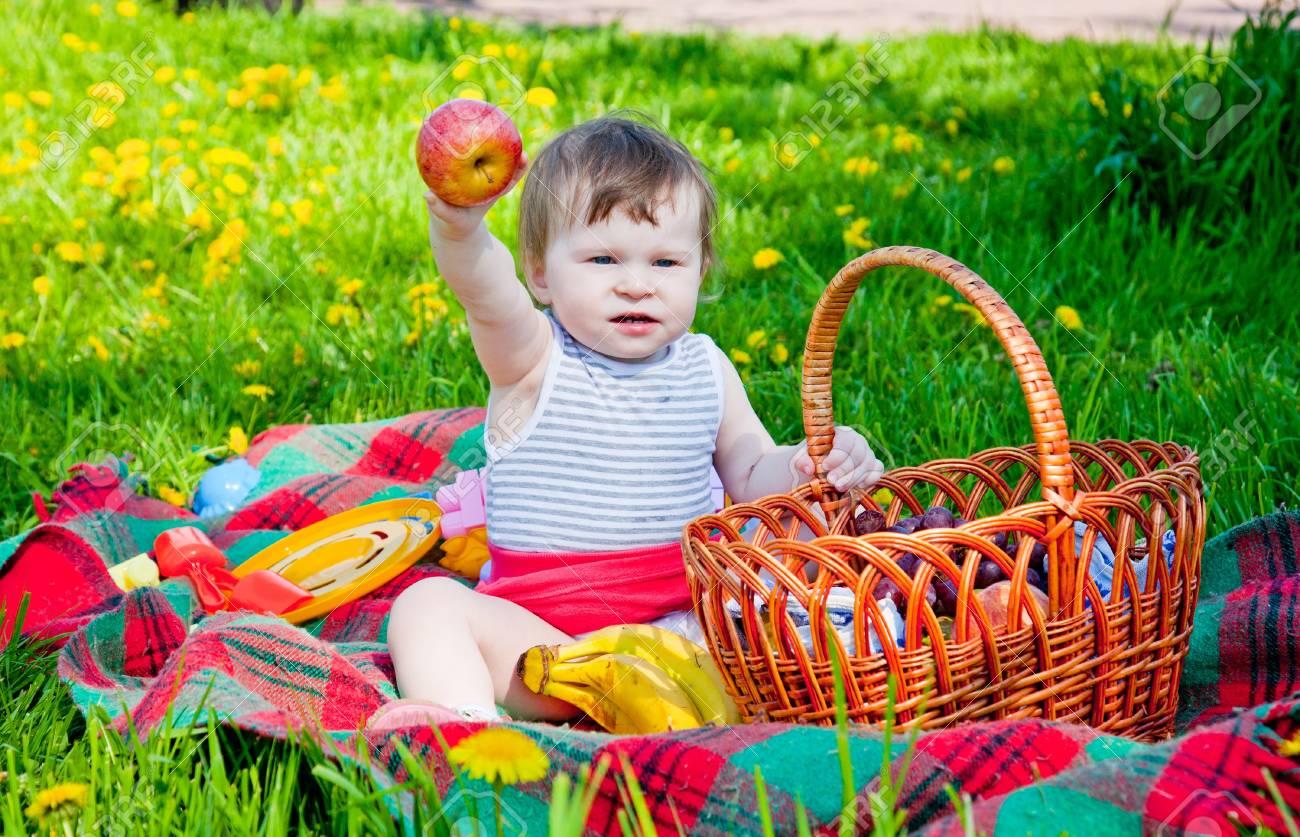 Child having picnic in summer park Stock Photo - 9918789