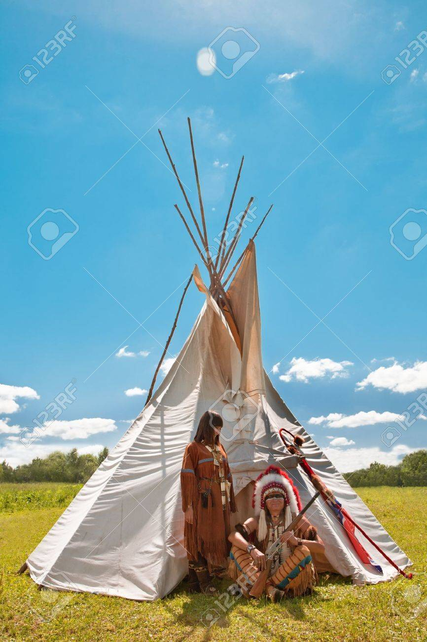 Group of North American Indians about a wigwam Stock Photo - 10292824