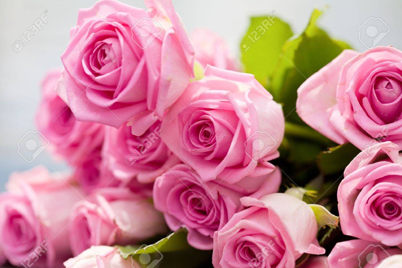 bouquet of pink roses lies on a pool side - 10603985