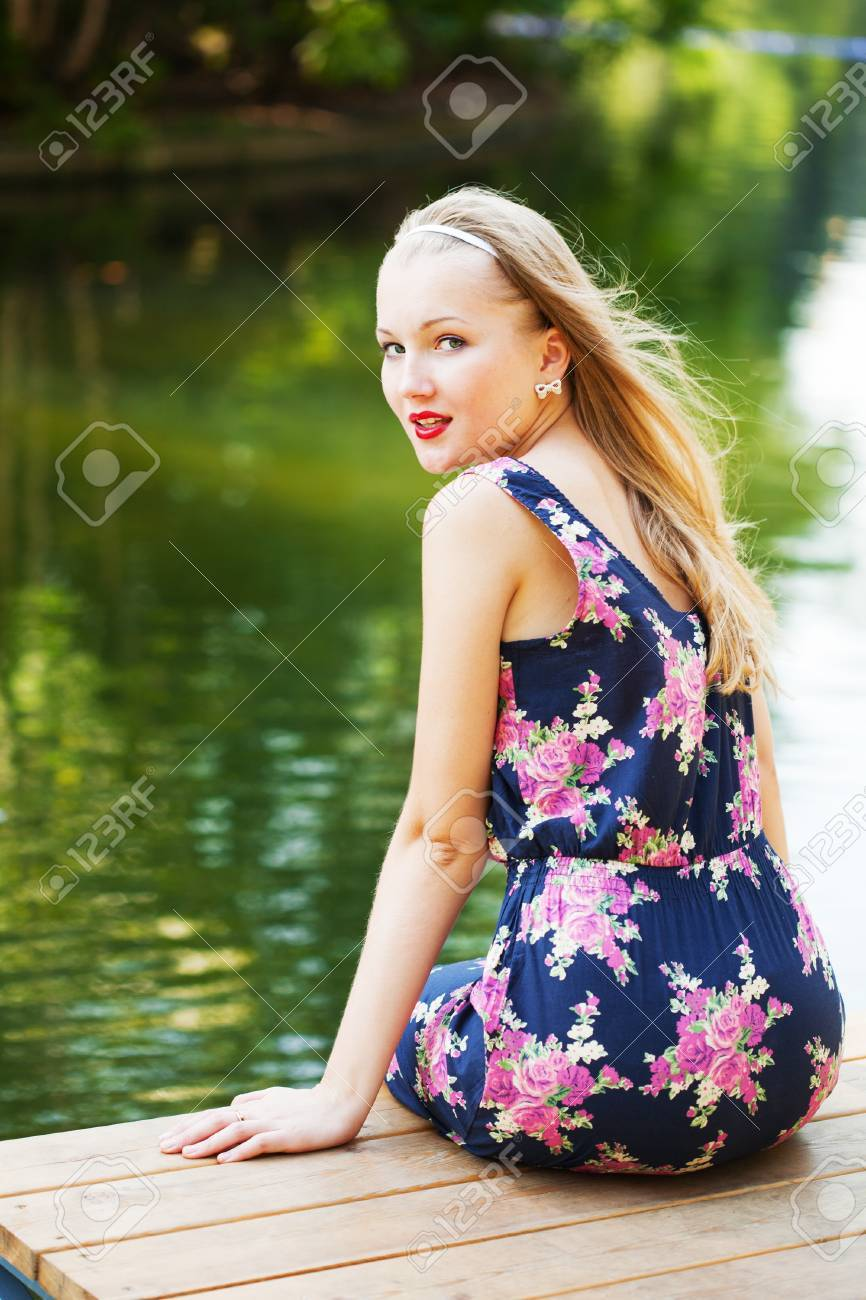 beautiful girl with long hair has a rest at water Stock Photo - 13153836