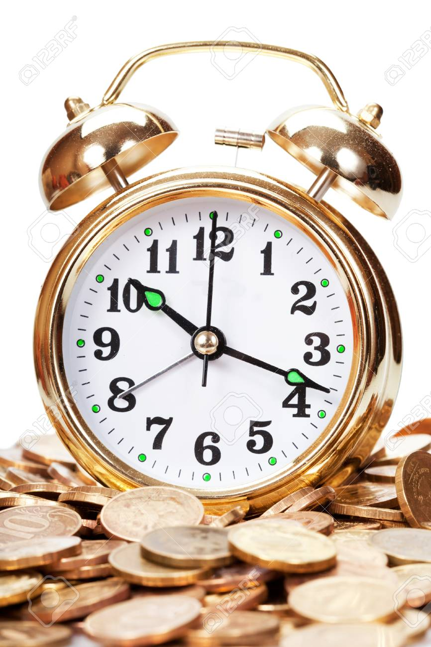 Great golden alarm clock faces on coins. Time is money Stock Photo - 13088586