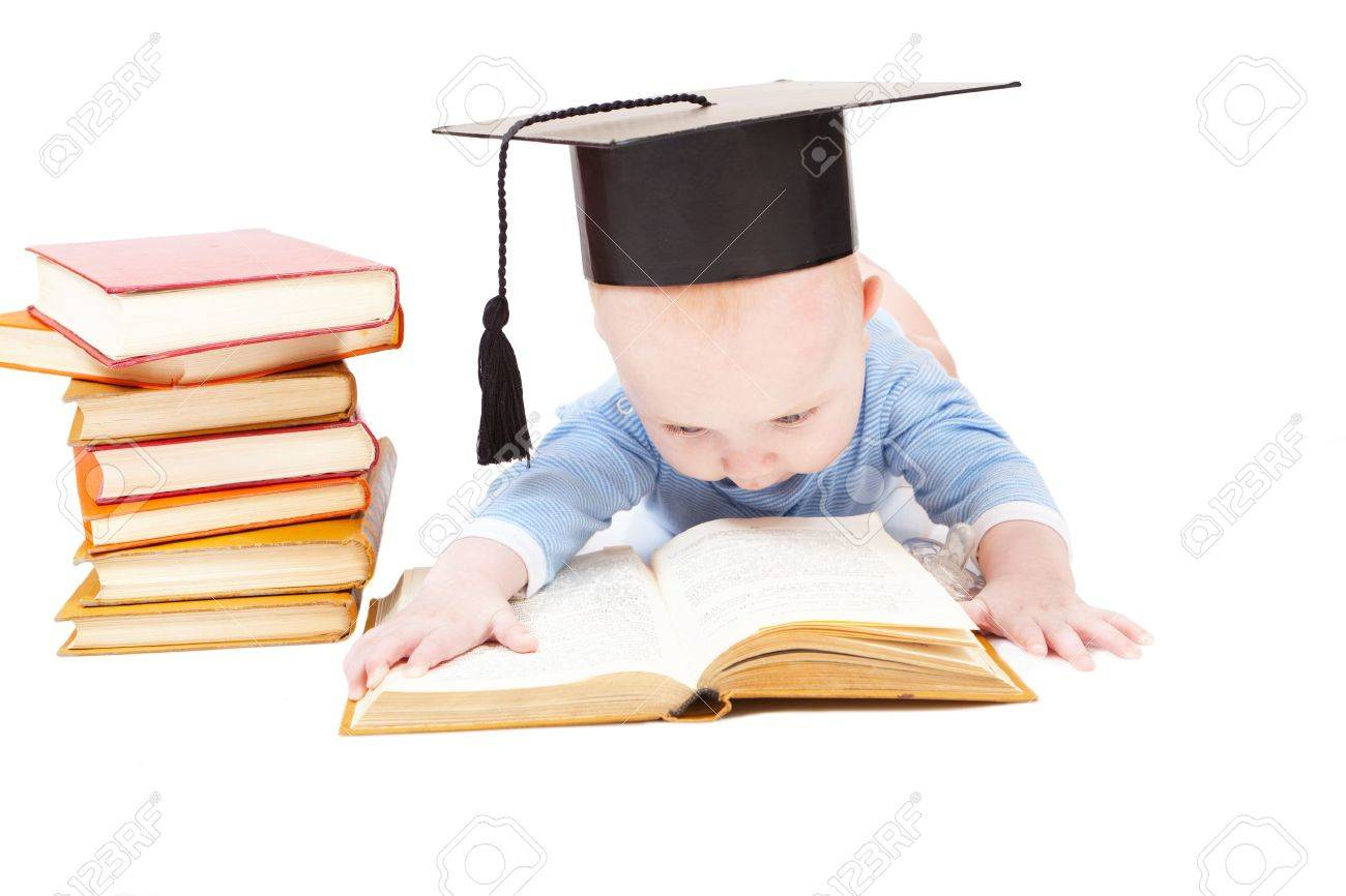 kid in a hat of the bachelor and the book. Concept of early education Stock Photo - 13365930