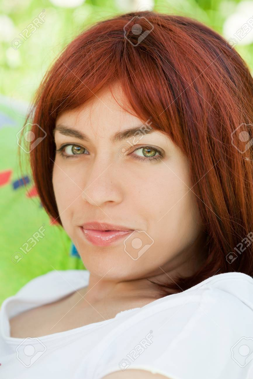 Summer portrait beautiful the girl with red hair Stock Photo - 14841693