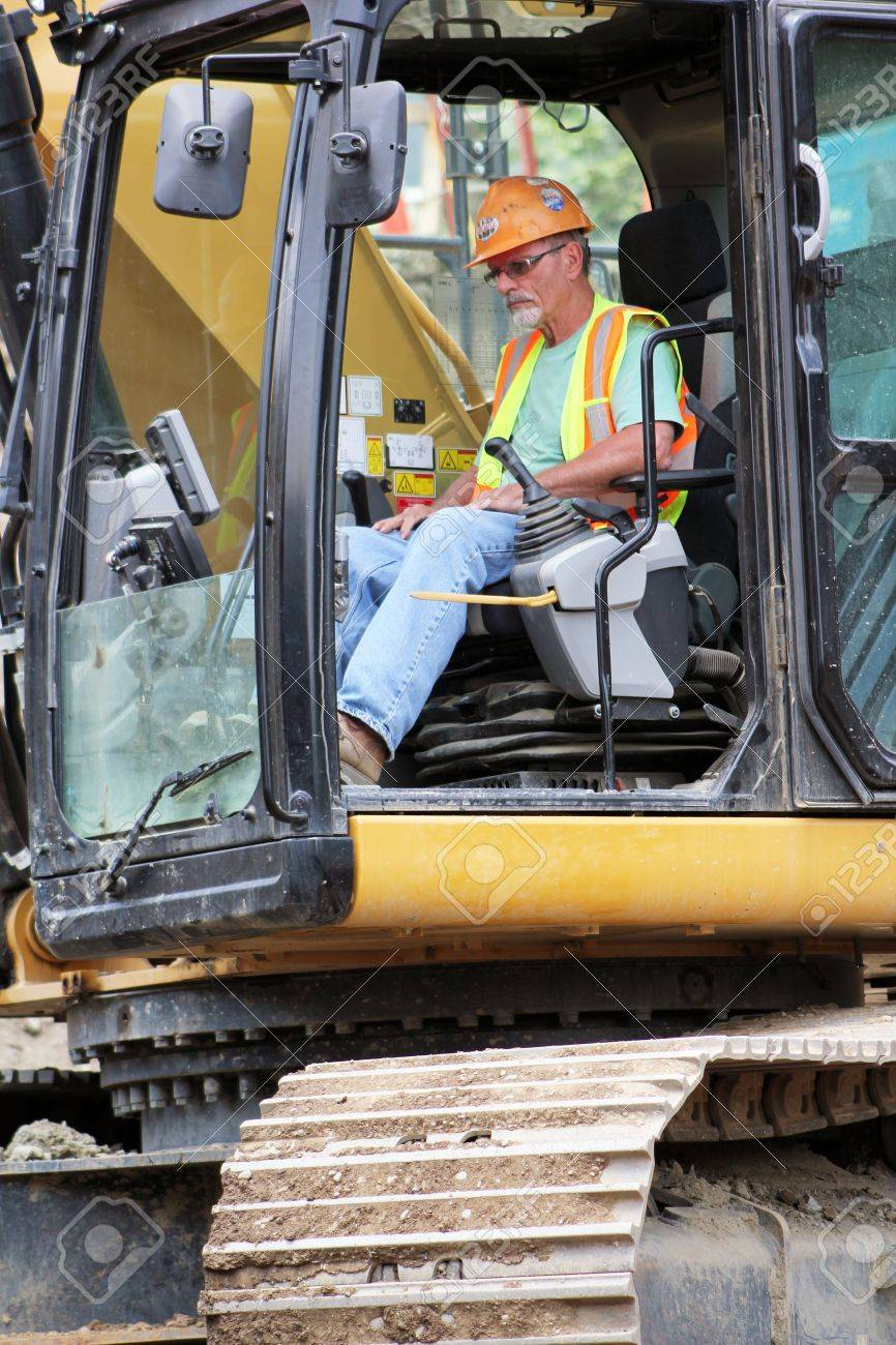 a front end loader heavy equipment operator in the cab of his