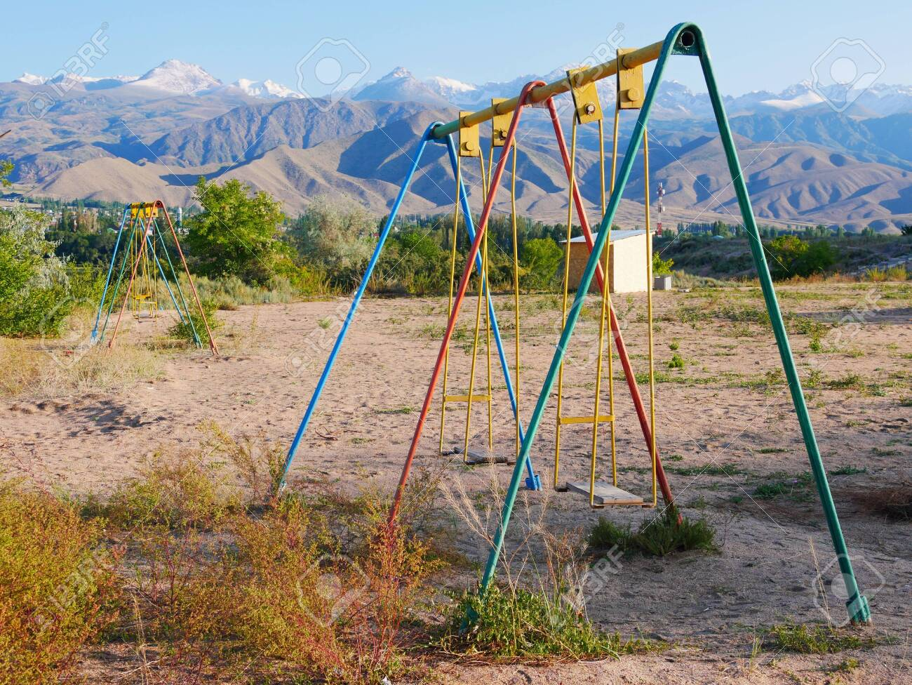 Swing On Abandoned Playground In Kyrgyzstan Stock Photo Picture And Royalty Free Image Image 132484419