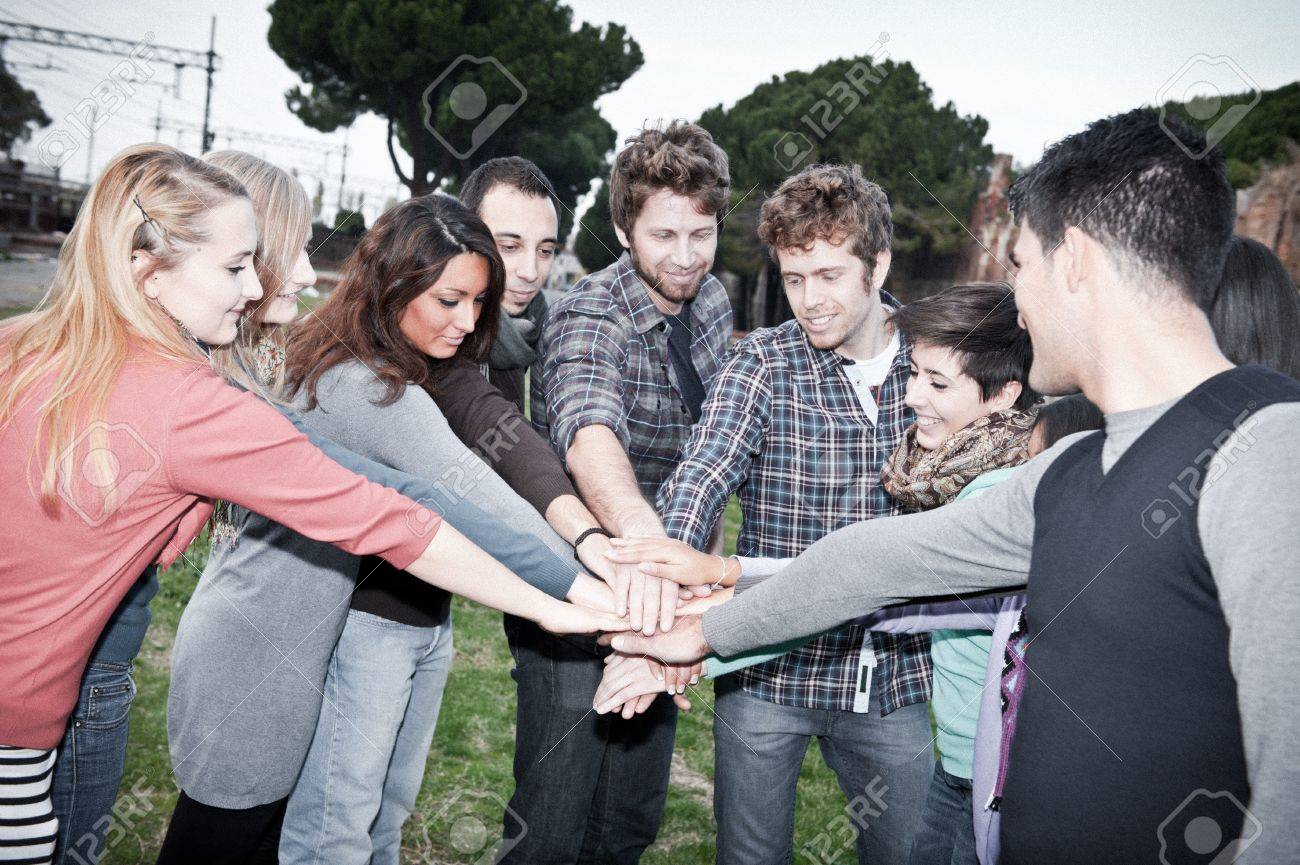 A group of multiracial students with hands on stack Stock Photo - 11510990
